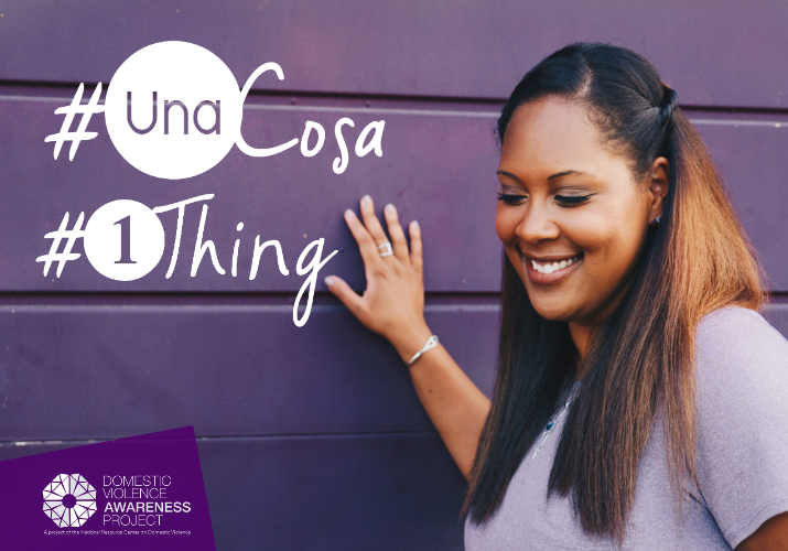 African American woman leaning against a purple wall. #1Thing #UnaCosa
