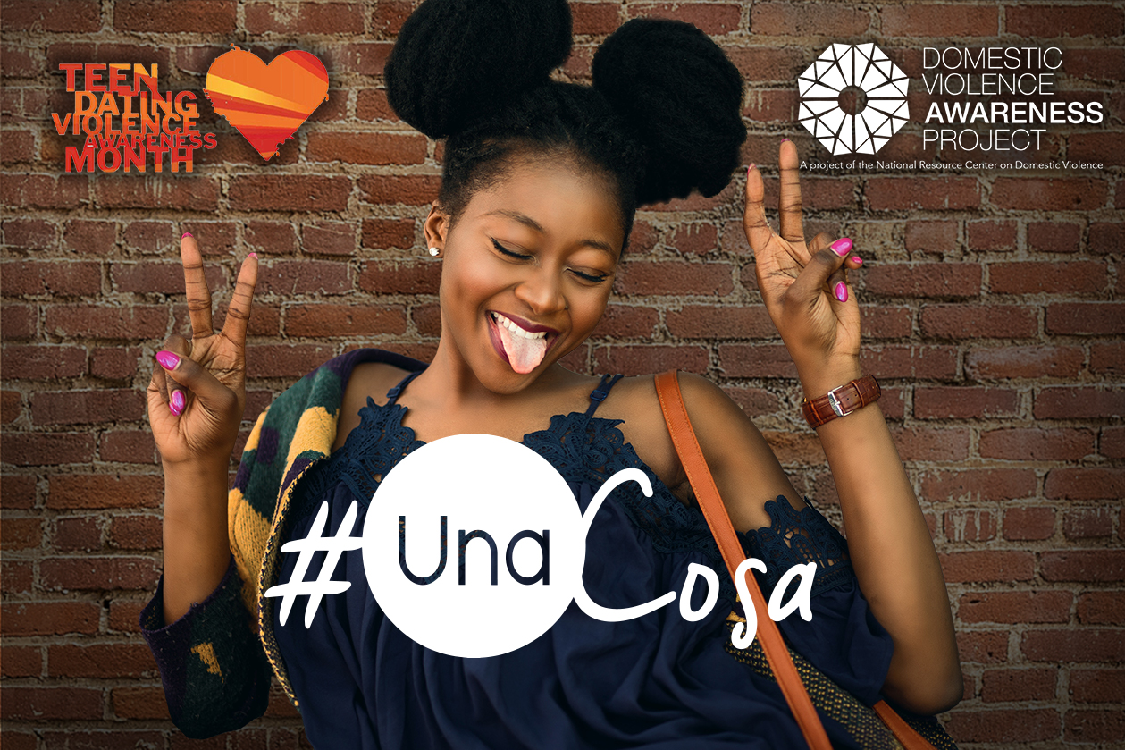 #UnaCosa logo imposed over image of girl posing in front of a brick wall