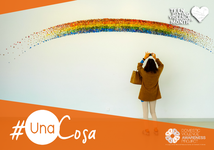 woman taking a photo of a rainbow art installation  #unaCosa